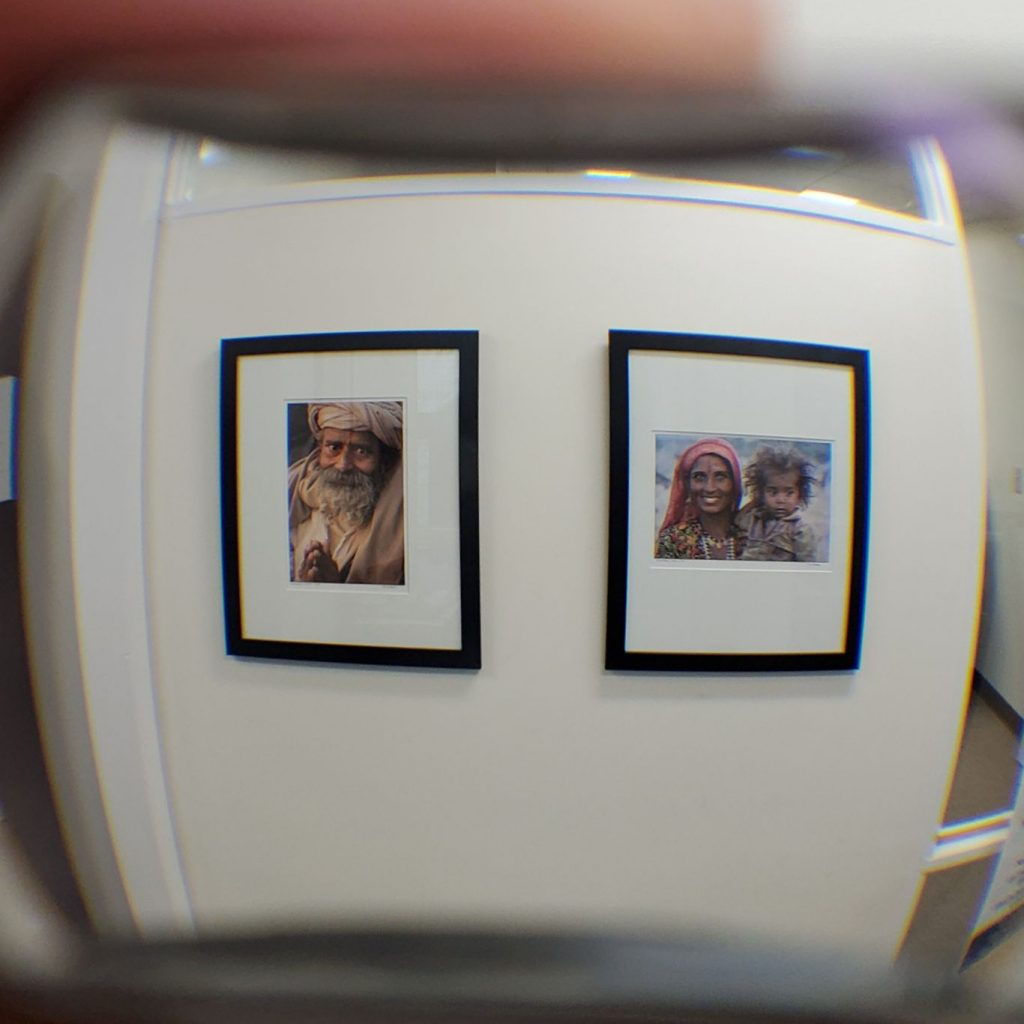 Image of 2 frames on wall with barrel tunnel vision distortion