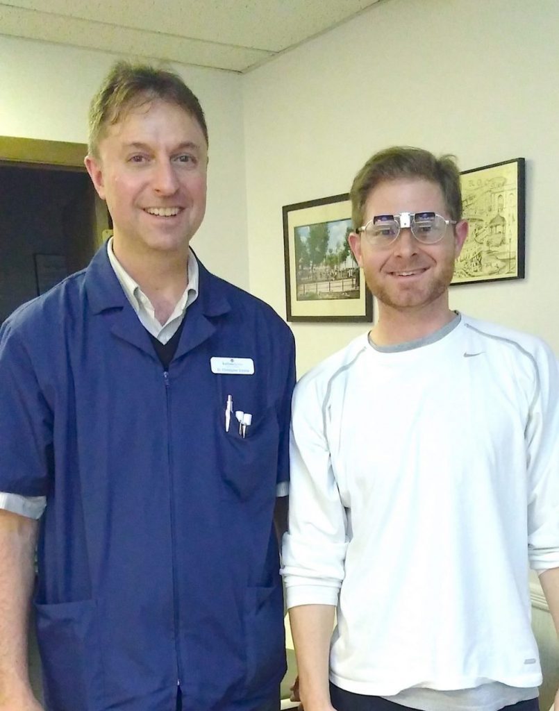 Image of Patrick Raymond and his low vision specialist